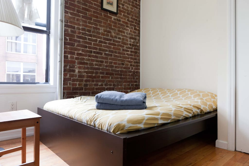 Your room - south facing, lots of light, clean with exposed brick.
