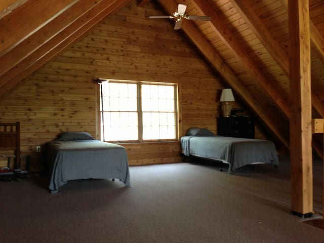 Spacious upstairs loft with 2 single beds!