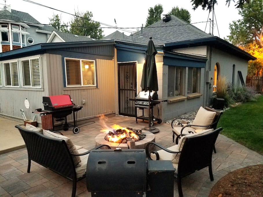 Roomy back yard is perfect for grilling, a game of cornhole, or enjoying S'mores by the fire pit.