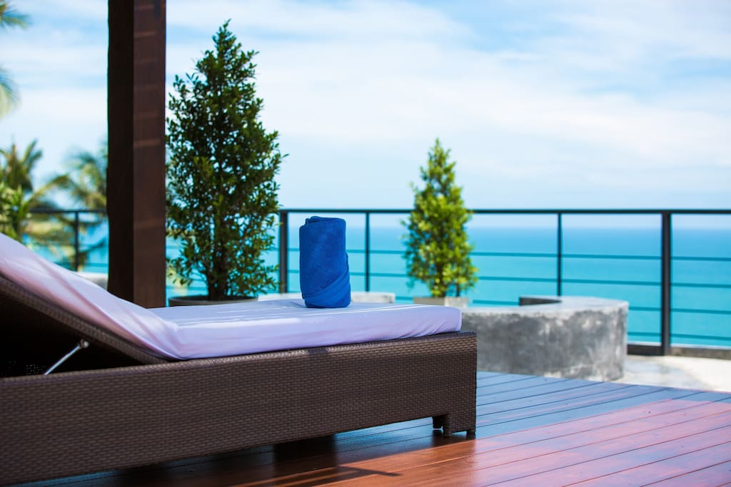 Resort shared roof top terrace with sunbeds with stunning sea view and mountain view