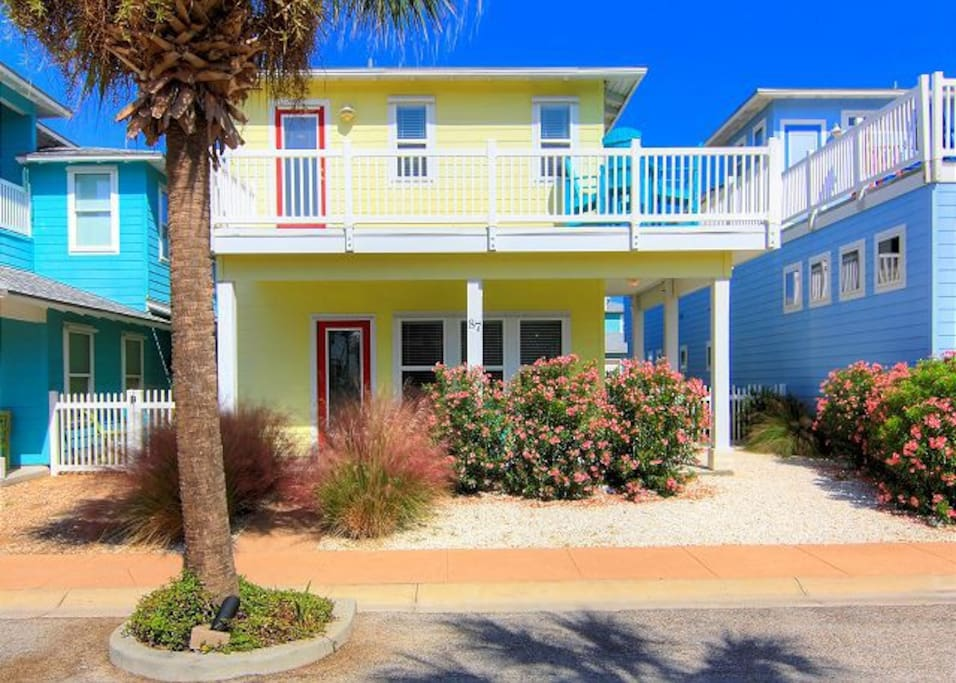 The brightly colored house with spacious balcony