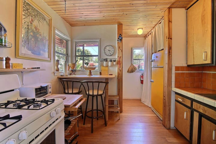 Kitchen with small seating area for two people - we have an old fridge from the 60´s we love!