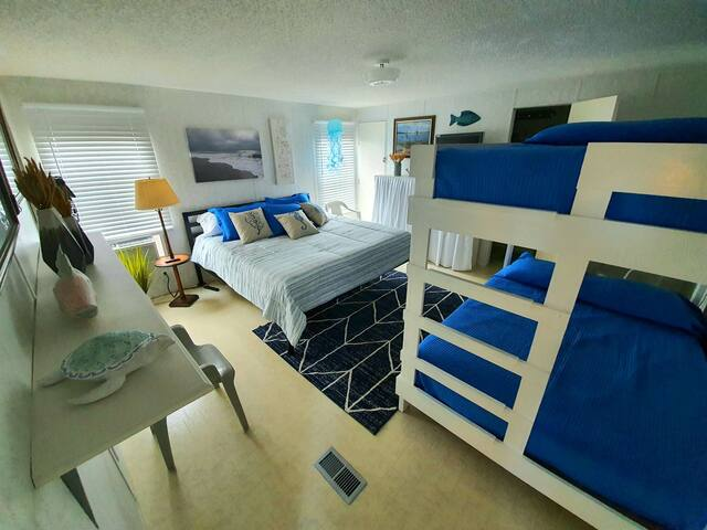 Master bedroom has a King bed and full size bunk beds.