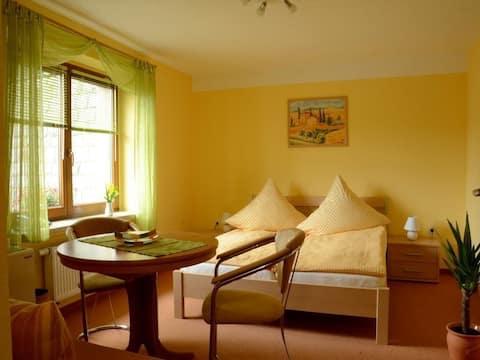 Apartament de vacanță în apropiere de natură în Munții Paștelui