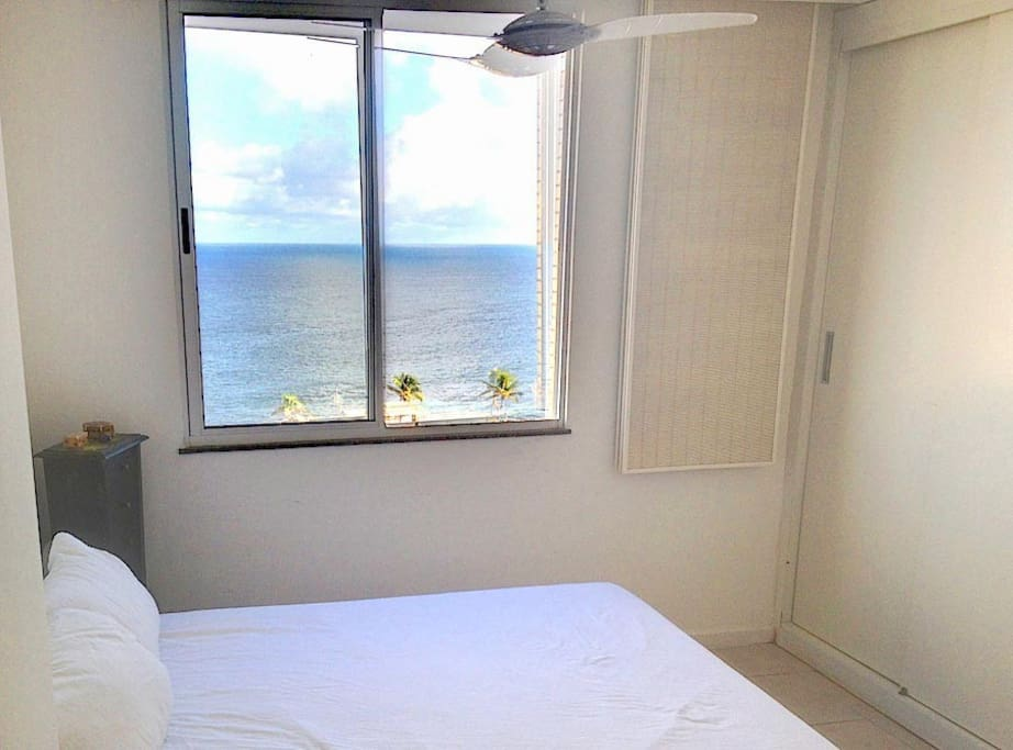 Master bedroom with wardrobe, ceiling fan and ocean view. Current photo June 2013.