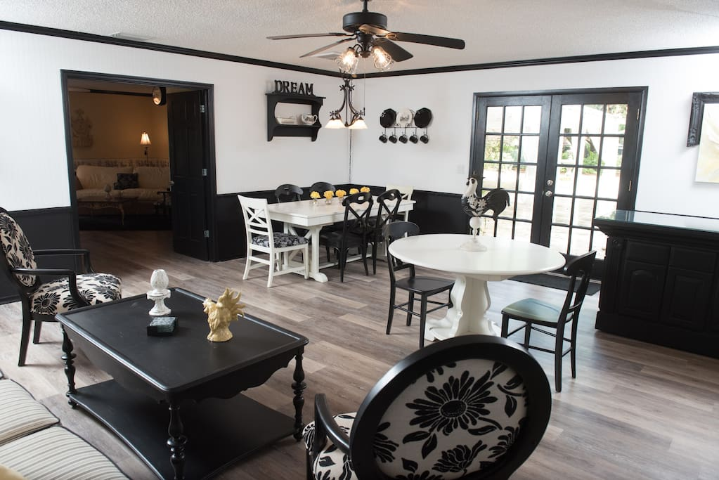 Formal dining area with an expandable dining table and view into the Master bedroom.