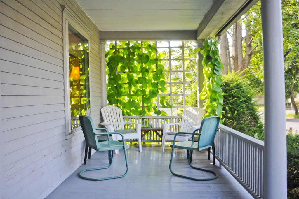 The porch is a nice place to gather for drinks and is shaded by a dutchman's pipe vine.