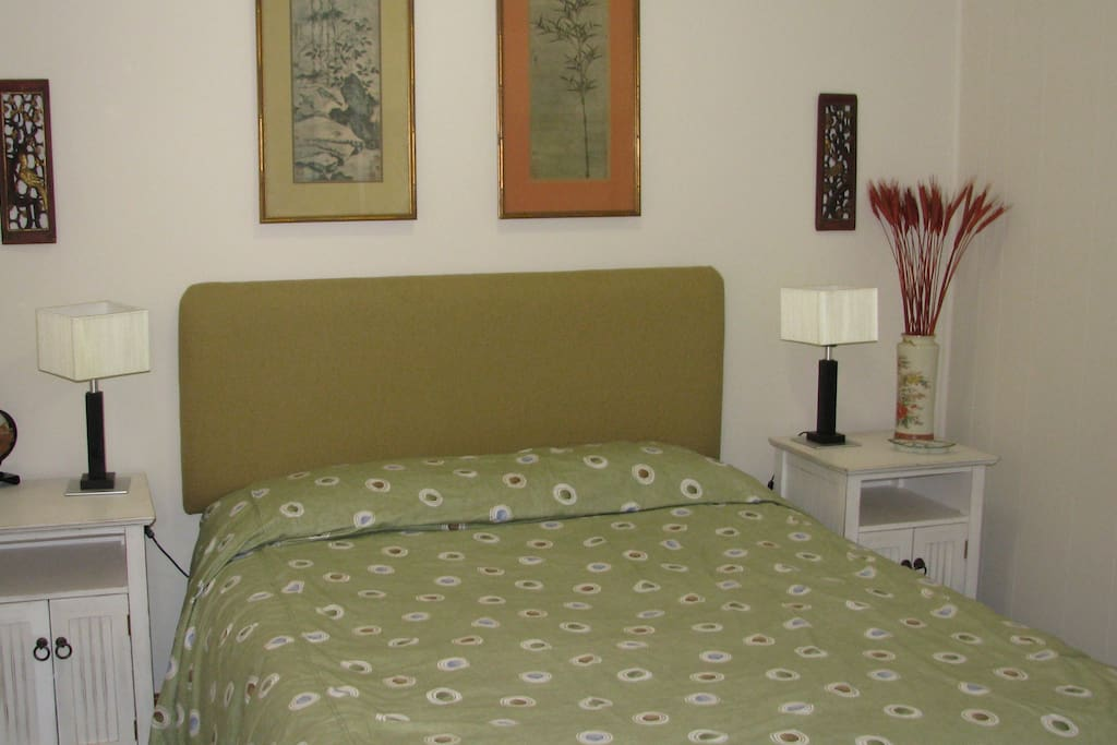 This is the Main bedroom with a double bed, comfortable mattress, and built-in cupboards.