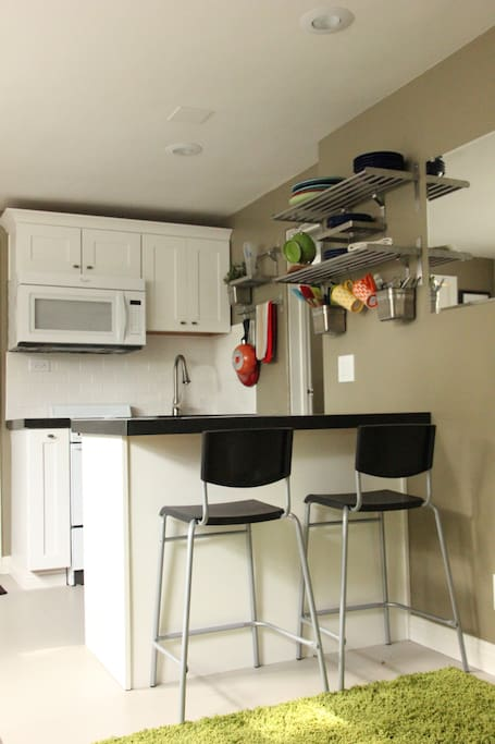 Full kitchenette with new appliances: microwave, refrigerator and stove