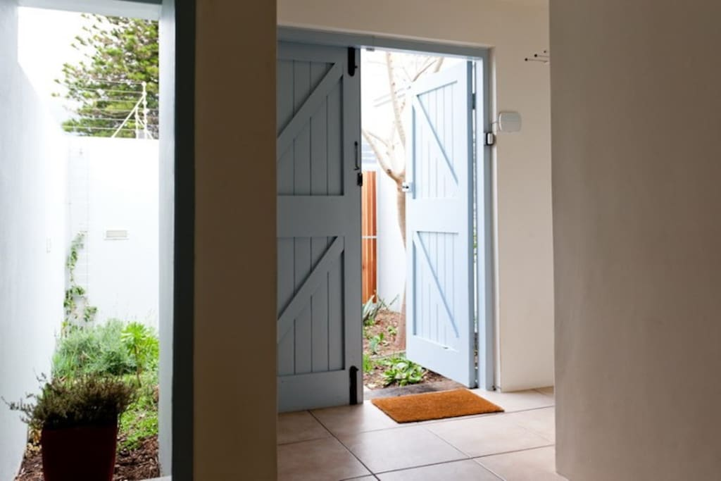 Front door leads to small courtyard garden and front gate; excellent security, recently upgraded!