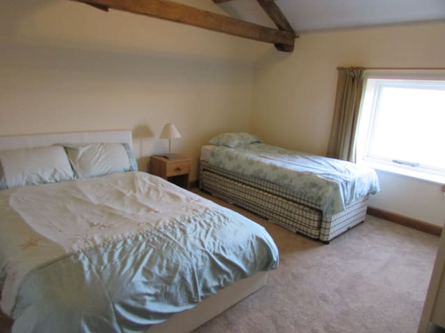 Family room with double bed plus two single beds.