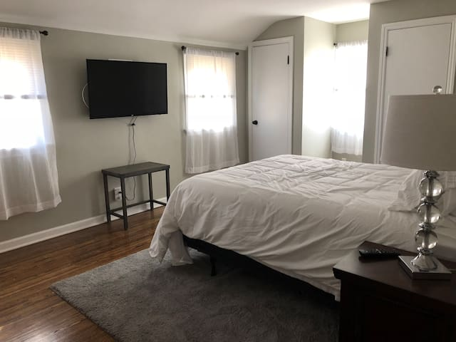 Master bedroom with TV, Apple TV, ironing board and iron