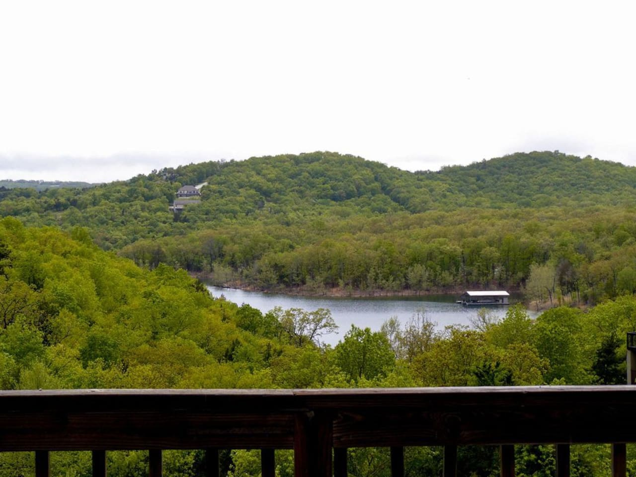 Beautiful views of the Ozark mountains from the large back balcony. Seating for 8 people to enjoy the serenity of the lake and mountains.