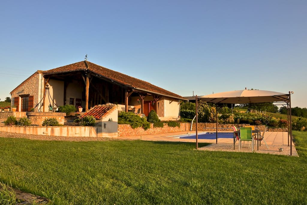 The Pool and terrace on the top of our hill with the barn in the background.