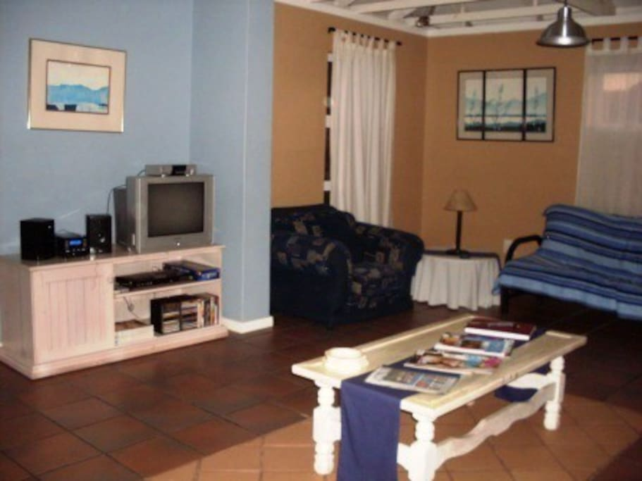 Lounge with DStv Satelite television, DVD-player and CD/Radio, Indoor braai (BBQ) and breakfast nook