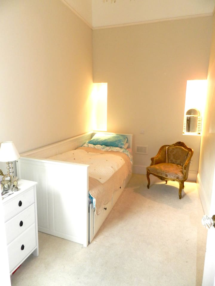 Single bed with storage drawers beneath, and additional chest of drawers