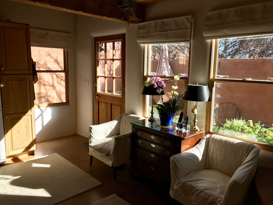 Sunny front room with cable TV.