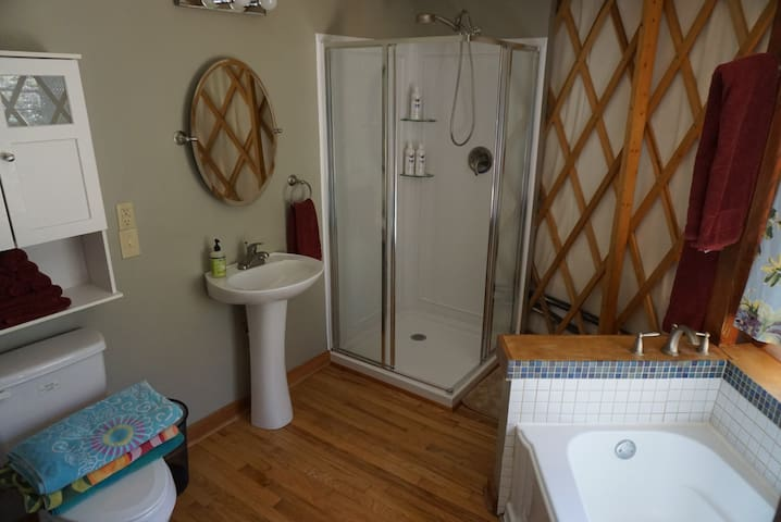 The bathroom has a powerful shower and a full deep tub for your convenience.