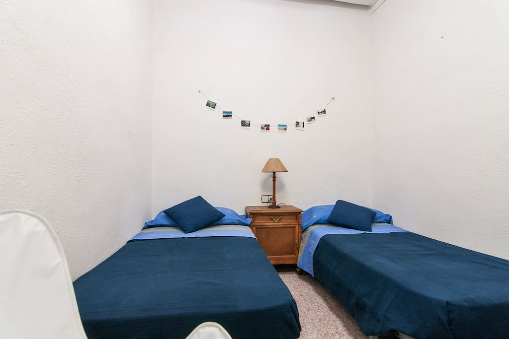 Large room with two individual beds