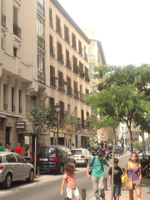 Tourists strolling past house on Calle de Jesus