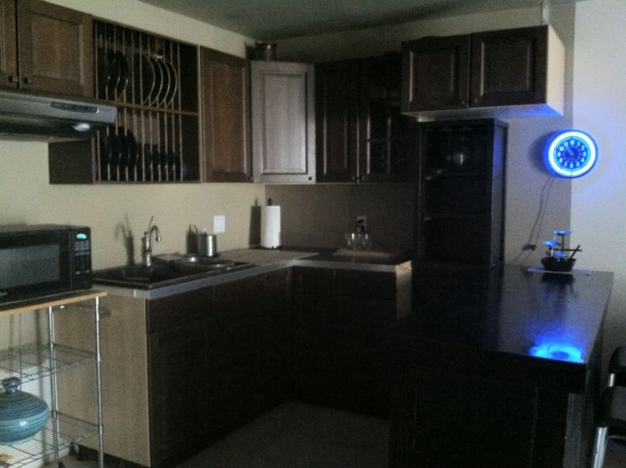 Kitchenette equiped with mini fridge, microwave oven, coffee maker, breakfast bar, plates and utensils