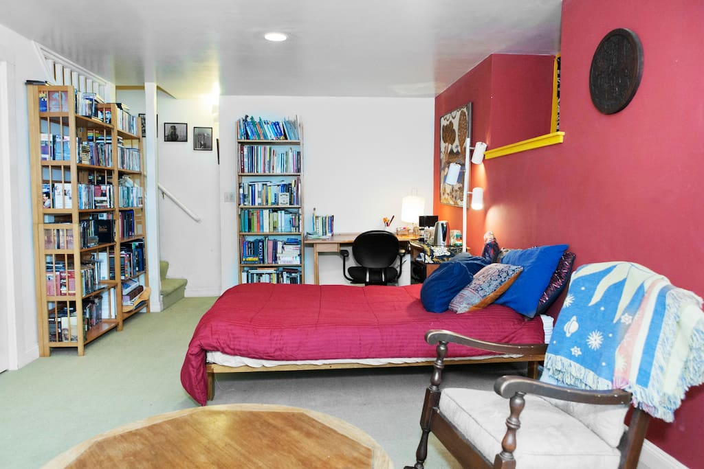 Large room with queen bed and extensive travel resource library.