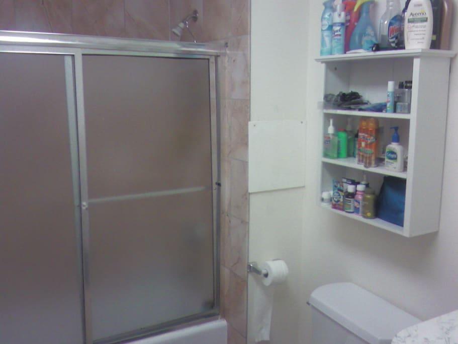 Women's bathroom with bathtub/shower.