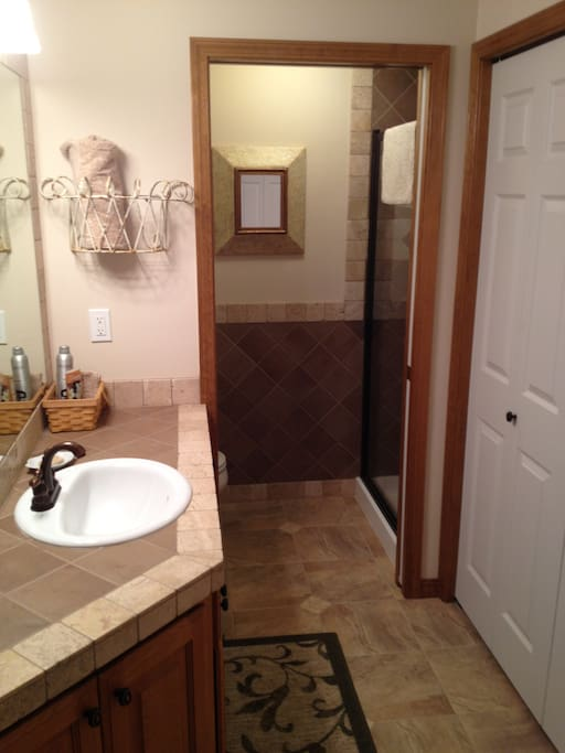 Guest Suite bath with pocket door to toilet and shower.