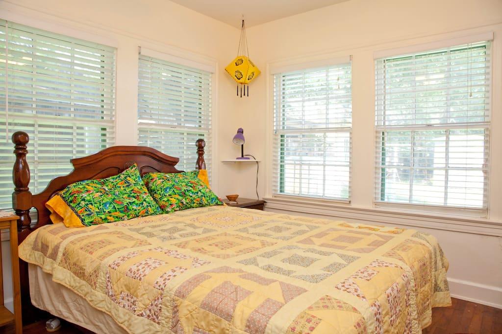 Queen size bed.  Room has lots of windows, but then blinds to darken it