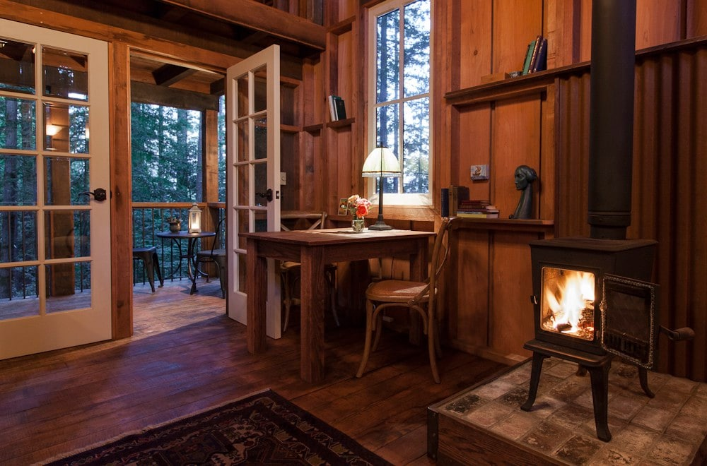 Cabin Living Area With Woodstove, Doors To Deck, And Table Ready For Your  Creative ...