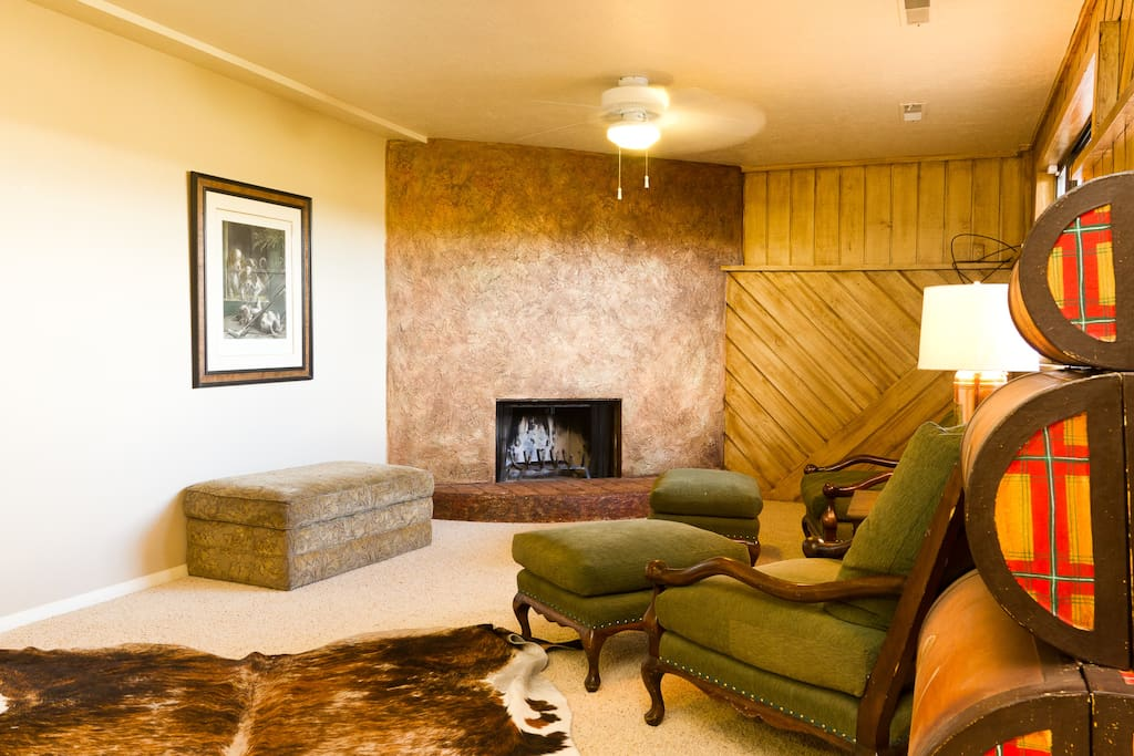 Wood burning fireplace in large family room.