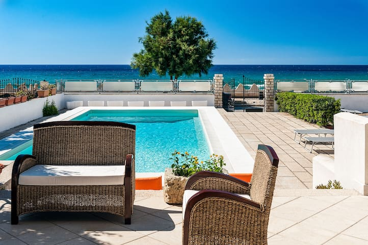 Sea front private villa with pool and stunning views