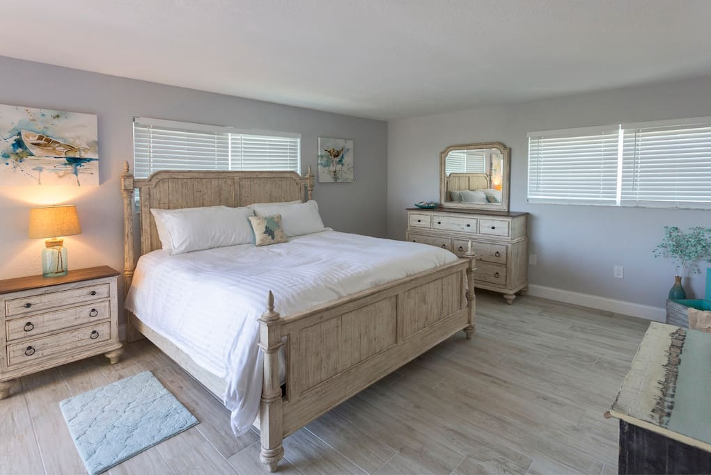 Master bedroom has a king size bed with its own bathroom and full-large walk in closet