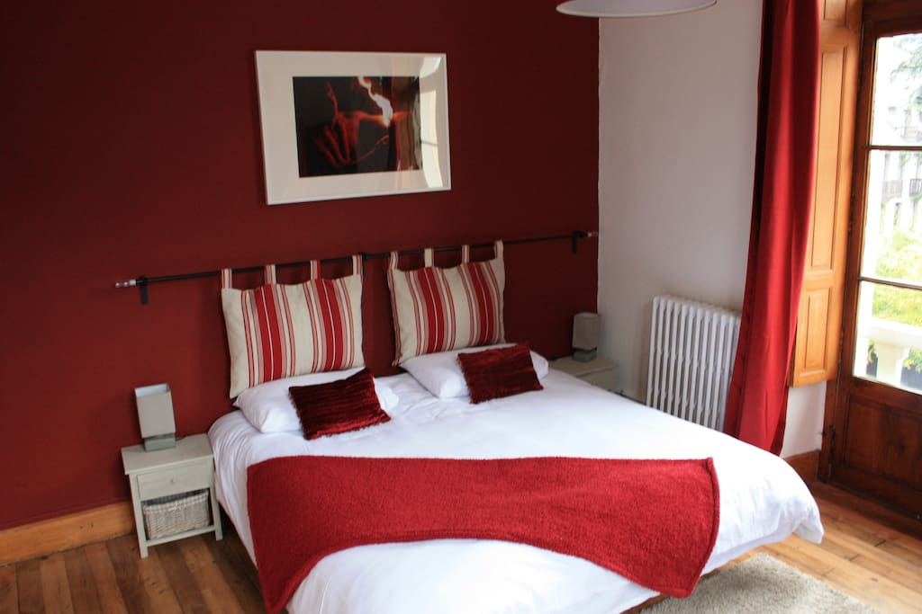 The red room in the daylight - super-king or twin set up with the option of a fold up bed or cot