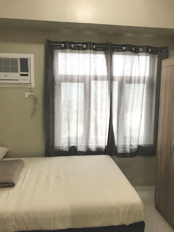 Bed Room Side View w/ Curtains