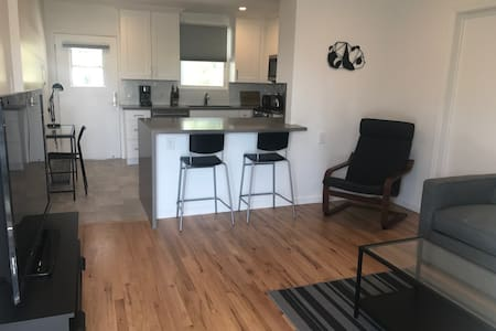 Newly Renovated Unit with Tree-lined Views