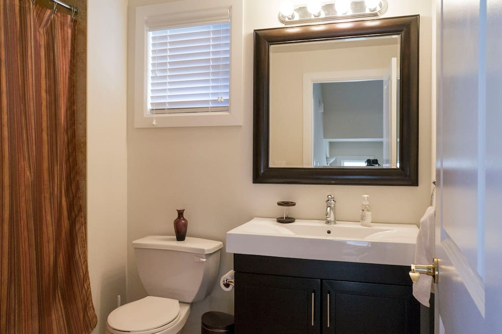 Here is the bathroom, right next to your bedroom. It shared with another guest.