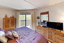 Stretch out in the master bedroom and watch favorite shows on the TV.