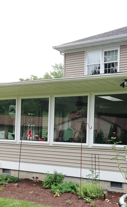 Our back porch which looks out on our very green grass.