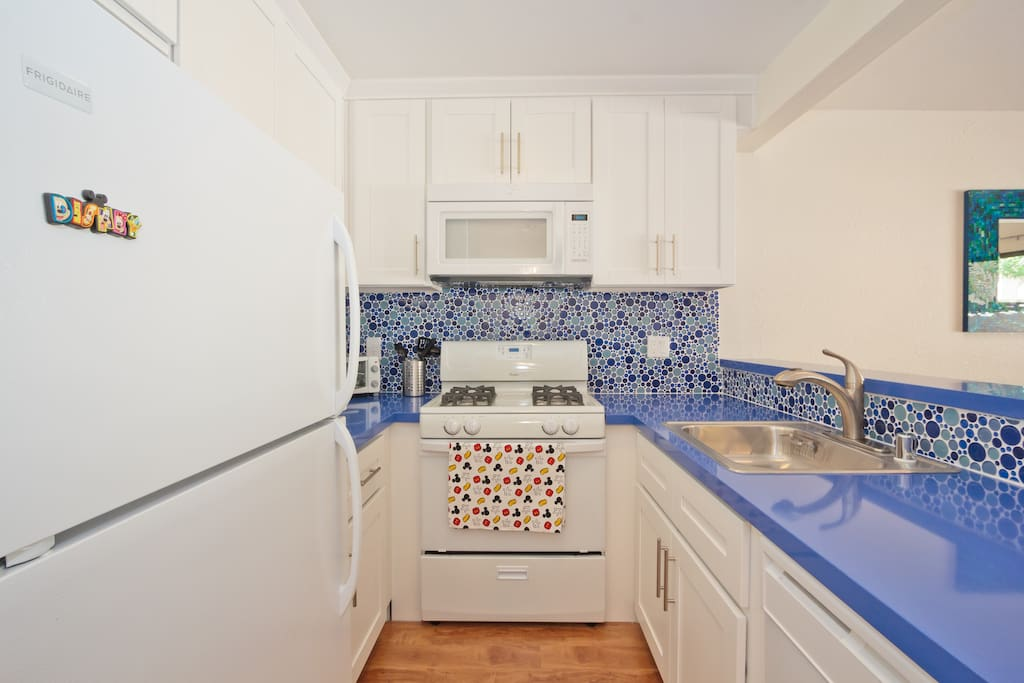 Beautiful Kitchen with Blue Countertops and Fun Blue BackSplash