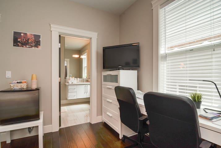 Includes desk, dresser, TV, and mini fridge