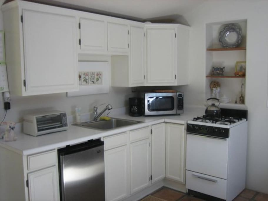 Fully equipped kitchen.  Larger size refrigerator with freezer in other room