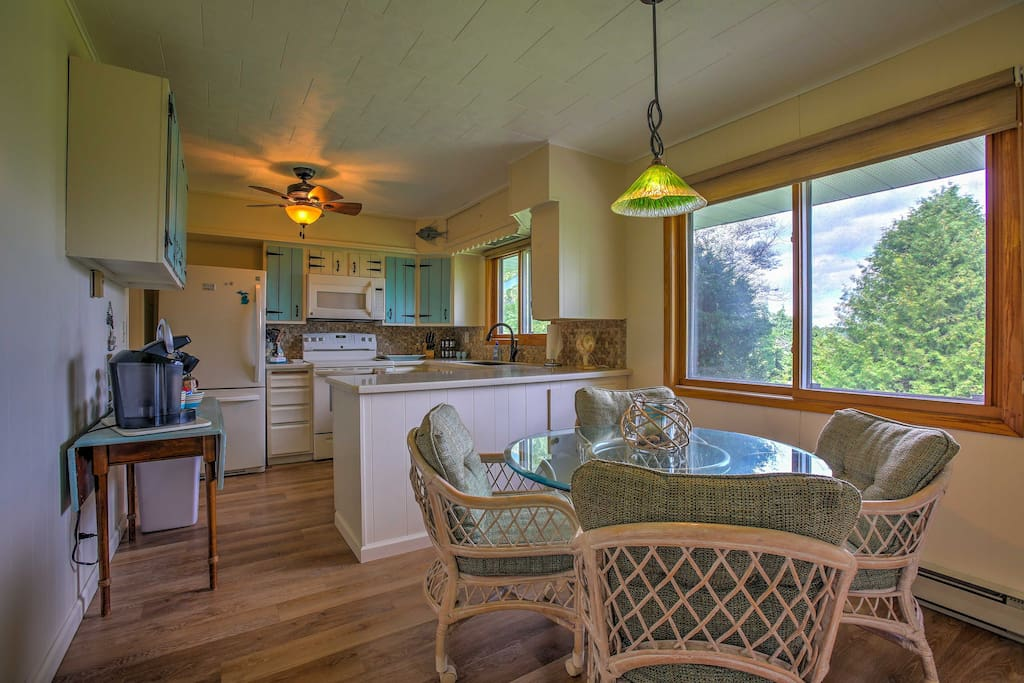 Enjoy incredible views of the woods from large windows in the home.