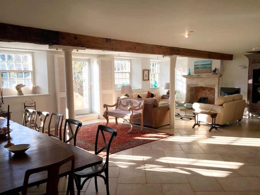 A large, comfortable living area leads through to the dining space