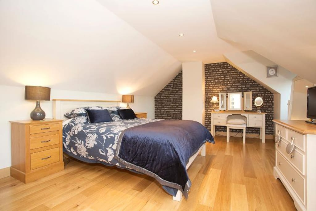 Comfortable king sized bed in the upstairs bedroom.