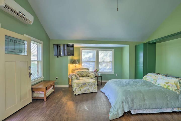 Queen size bed with a TV or window view