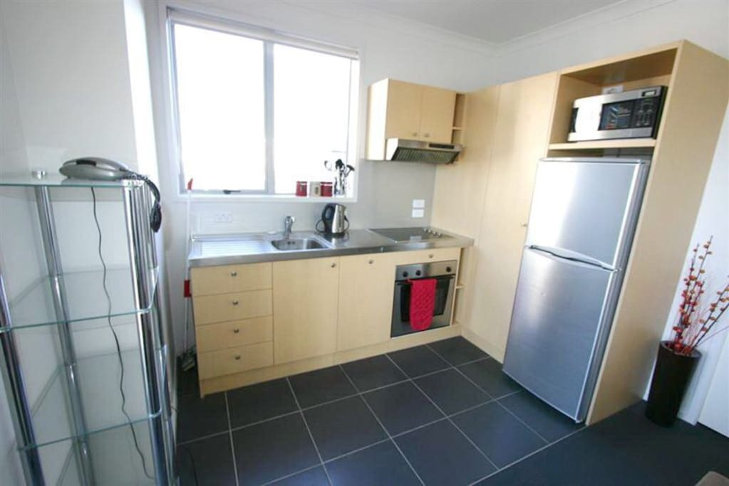Kitchen with white ware and kitchen utensil that free of use