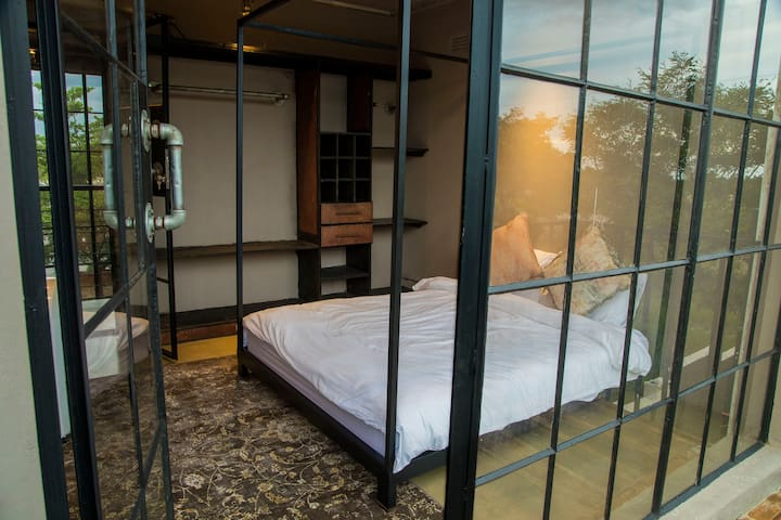 Bedroom 2 - with balcony overlooking lush landscape