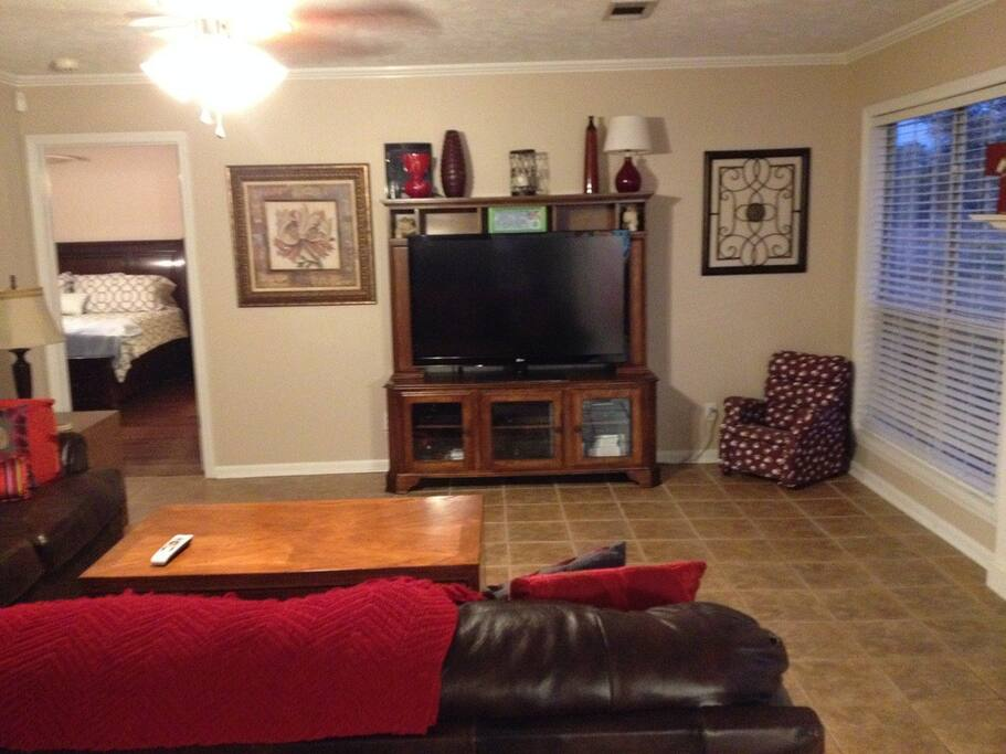 """Living room with 55"""" HDTV."""