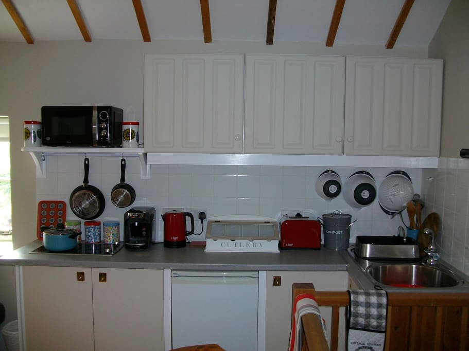 with well stocked galley kitchen